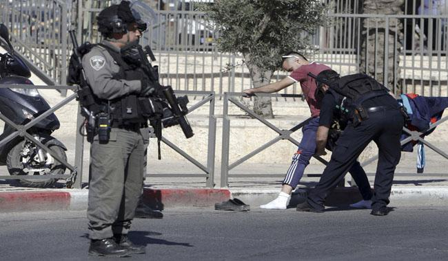 Israeli officer stabbed, three attackers shot in Jerusalem: police
