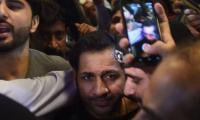 Triumphant Pakistani cricketers return to rousing welcome after clinching maiden Champions Trophy title