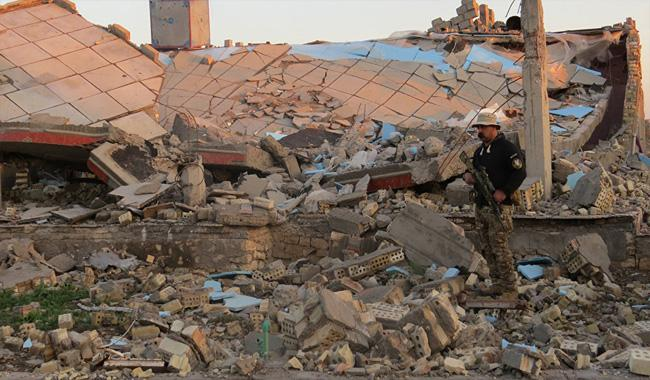 Suicide bomber kills 14 at camp for Iraq displaced