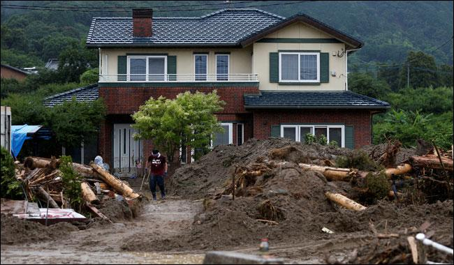 Death toll at 21 after floods, landslides hit Japan