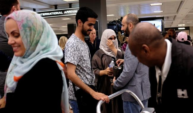 US to appeal ruling weakening Trump travel ban