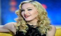 Madonna asks court to block love letter auction