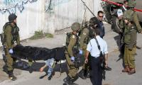 Three Israelis stabbed to death in West Bank settlement: army