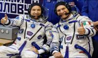Three-man crew reaches space station to boost research