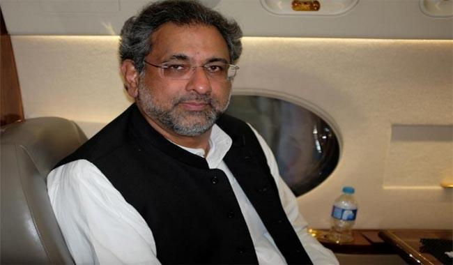 Pakistan's skydiving PM Abbasi seen soothing military, energy fears
