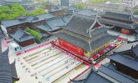 Chinese workers move 2,000-tonne temple whole during relocation