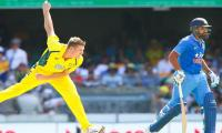 Australia bowlers keep India in check after Kohli bash