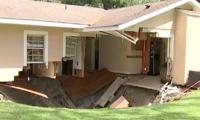 Video: sinkhole swallows house in US