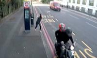 Moped muggers snatch woman's phone in broad daylight