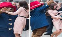 Kate looks lovely while dancing with Paddington Bear