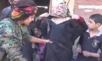 Woman rips off burqa in celebration of her hometown's liberation from Daesh