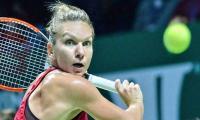 Top-ranked Halep crushes Garcia at WTA Finals