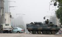 Zimbabwe army stops crowd marching on Mugabe´s official home