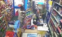Shocking CCTV footage shows policeman shooting while holding infant
