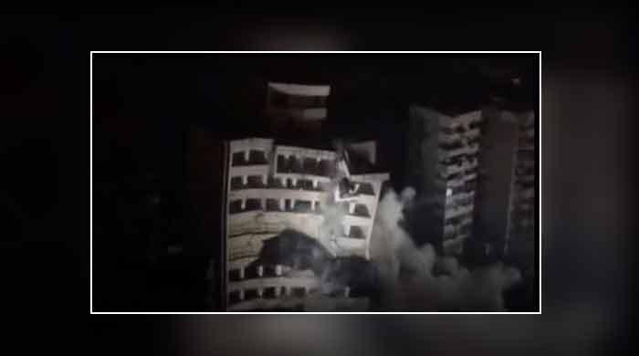 Multi-storey building demolished in China