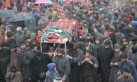 Four martyred in IoK: Kashmiri woman's body wrapped in Pakistani flag before burial
