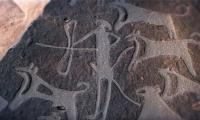 Engravings in Saudi desert  termed oldest Known depictions of dogs on leashes