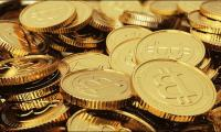 Bitcoin hits new record high as warnings grow louder