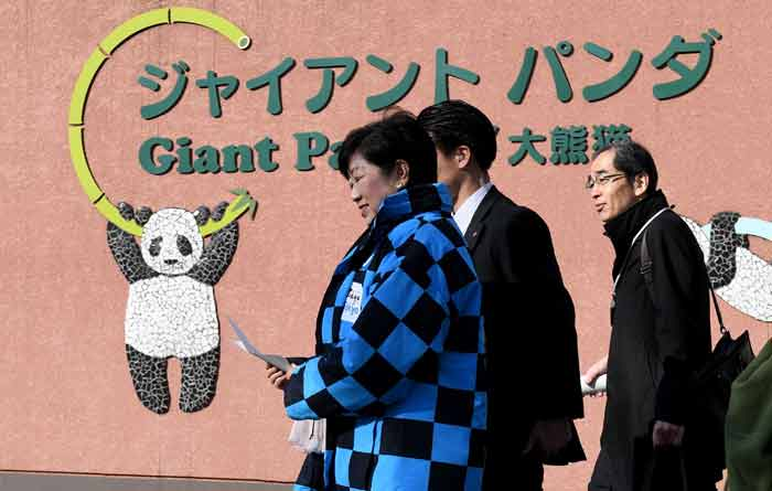 Tokyo Governor Yuriko Koike (L) leaves the panda house after seeing newly-born giant panda cub Xiang Xiang at Ueno Zoo in Tokyo on December 18, 2017. -AFP