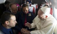 Pope Francis marries couple aboard plane
