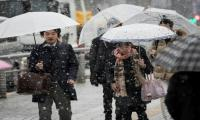 Dozens injured, transport disrupted as slow blankets Tokyo