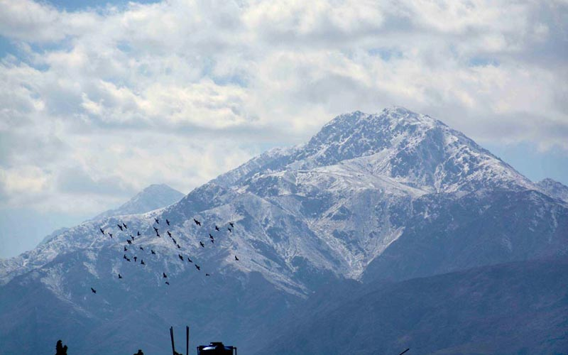 An eye catching view of snow-covered mountains in Quetta Valley.