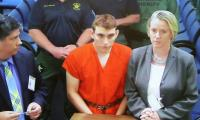 White supremacist says Florida shooter was group member