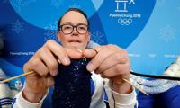 Finnish coach knitting at the Winter Olympics is making heads turn