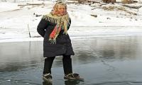 76-year-old granny performs ice-skating stunt on world's deepest lake