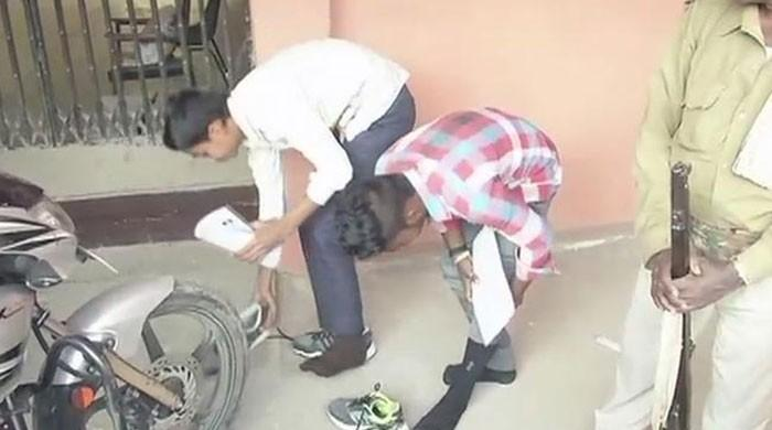 Indian students barred from wearing socks and shoes to exam hall