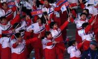 Two Koreas march apart as Winter Olympics close