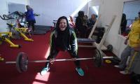 Afghan female powerlifters flex their muscles