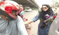 Female traffic warden distributes chocolate and flowers