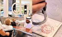 Tourists stamped with 'smiley visa' at Dubai Airport on Happiness Day