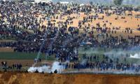 Clashes erupt along Gaza-Israel border as protests begin