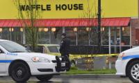 US hunts semi-nude gunman disarmed by ´hero´ after 4 killed