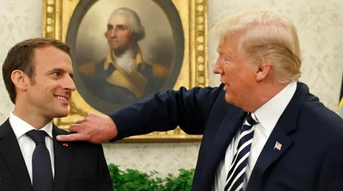 Trump makes President Macron 'perfect' by brushing away 'dandruff' from his jacket