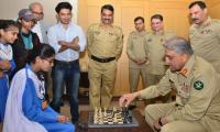 Army Chief General Bajwa plays chess with a talented student