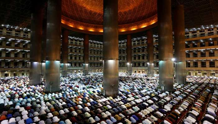 Indonesian Muslims pray at the first day of holy fasting month of Ramadan at Istiqlal mosque in Jakarta, Indonesia. REUTERS