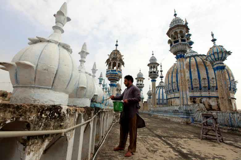 A man carries out cleaning work at Jamia Masjid (Grand Mosque) ahead of Muslim holy month of Ramadan in Rawalpindi, Pakistan. REUTERS
