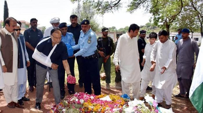 Ahsan Iqbal visits family of colonel martyred in Quetta operation