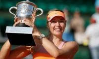 True grit Sharapova back at French Open with point to prove