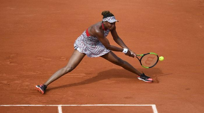 Venus knocked out by China´s Wang in first round