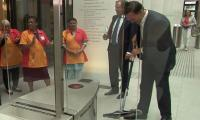 Video of Dutch PM cleaning up coffee with mop goes viral