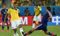 Japan beat 10-man Colombia to make World Cup history