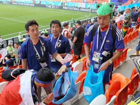 Image result for japanese fans clean stadium