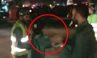 Woman beats up traffic warden in Lahore after he asks for her number