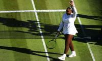 Serena battles into Wimbledon second round