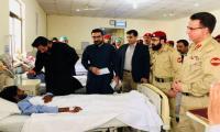 Shahid Afridi visits Mastung blast victims, meets martyred Raisani's family