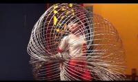 Chinese girl challenges the world as she spins numerous hula hoops around her